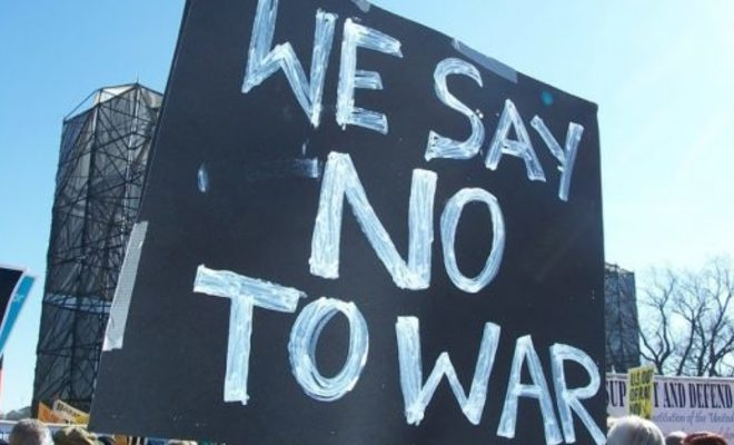 Large_we-say-no-to-war-sign-seen-at-a-2007-anti-war-protest.-photo-by-thiago-santos-on-flickr-e1534638830519