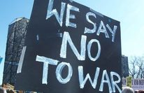 Medium_we-say-no-to-war-sign-seen-at-a-2007-anti-war-protest.-photo-by-thiago-santos-on-flickr-e1534638830519
